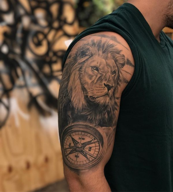 lion tattoo designs body pics image ideas 27 Fabulous realistic compass and lion tattoo on sleeve 72 Amazing Lion Tattoo Designs and Ideas For You